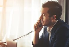 Business man making call in on Fax phone landline stock photography