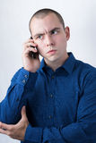 Business man making a call with serious face expression Stock Images