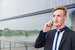 Business man making call with smartphone Royalty Free Stock Photo