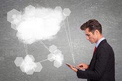 Business man making cloud connections on pad tablet Stock Photo
