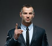 Business man making forefinger gesture Royalty Free Stock Photos