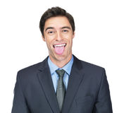 Business man making a funny face against white Stock Photo