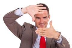 Business man making hand frame Royalty Free Stock Image