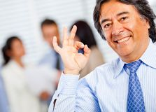 Business man making ok sign Stock Images