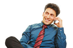 Business man making phone call with smartphone. Happy business man making a phone call with his smartphone in an office chair Stock Images