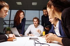 Business man making presentation at office. Business executive delivering presentation to his colleagues during meeting or in-house business training Stock Photos