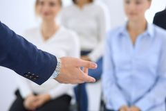 Business man making presentation to group of people. Speaker delivering a seminar to his colleagues or business training stock photography