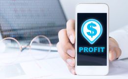 Business man is making profit trading. On smartphone Stock Photography