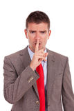 Business man making silence Royalty Free Stock Photography