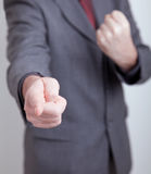 Business man making a threat. Man in suit making a threatening gesture. Very shallow DOF - focus on pointing finger Royalty Free Stock Photos