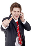 Business man making thumbs up gesture Royalty Free Stock Photography
