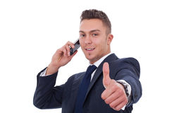 Business man making a thumbs up gesture Royalty Free Stock Image