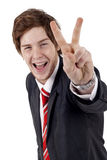 Business man making victory gesture Royalty Free Stock Photo