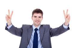 Business man making victory gesture Royalty Free Stock Photos