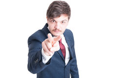 Business man making watching you gesture Royalty Free Stock Photos