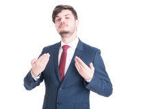 Business man or manager standing and posing arrogant. Making gesture with hands isolated on white background stock images