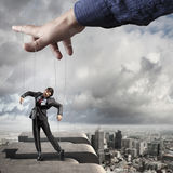 Business man marionette Stock Photos