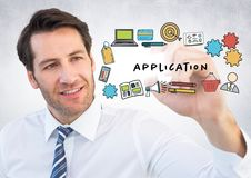 Business man with marker behind application doodles and flare against white wall. Digital composite of Business man with marker behind application doodles and Royalty Free Stock Photo