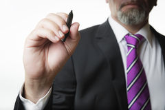 Business man with marker Royalty Free Stock Photos