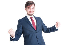 Business man or marketing manager making winner gesture Stock Photos