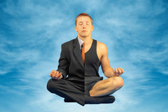 Business man is meditating Royalty Free Stock Images