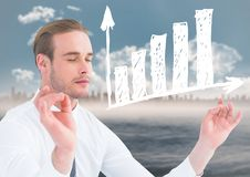 Business man meditating against blurry skyline and water with white graph. Digital composite of Business man meditating against blurry skyline and water with Stock Photo