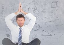 Business man meditating against light grey wall with math doodles. Digital composite of Business man meditating against light grey wall with math doodles Royalty Free Stock Photos