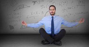 Business man meditating in grey room with math doodles. Digital composite of Business man meditating in grey room with math doodles Stock Image