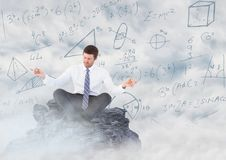Business man meditating on mountain peak among clouds against math doodles Royalty Free Stock Photo