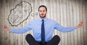Business man meditating with thought cloud showing math doodles against blurry wood panel. Digital composite of Business man meditating with thought cloud Stock Photo