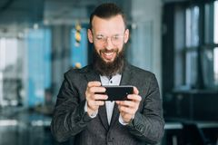 Business man messaging texting phone communication. Business man messaging or texting using phone. communication and mobile technology stock images