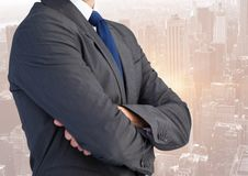 Business man mid section with arms folded against skyline Stock Photography