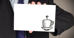 Business man mid section with card showing brown coffee doodle against brown background Royalty Free Stock Photography