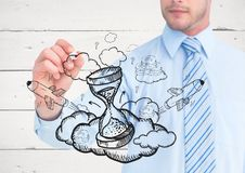Business man mid section drawing grey hourglass doodle against white wood panel Stock Photos