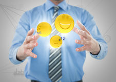 Business man mid section with flares and emojis between hands against white network. Digital composite of Business man mid section with flares and emojis between Stock Image