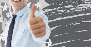 Business man mid section giving thumbs up against grey hand drawn american flag Royalty Free Stock Image