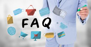 Business man mid section with marker behind faq doodles against blurry grey background. Digital composite of Business man mid section with marker behind faq Royalty Free Stock Image