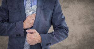 Business man mid section putting money away against brown grunge background Stock Image