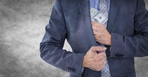 Business man mid section putting money away against white grunge background Stock Photos