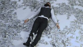 Business man, millionaire, billionaire, bearded man with many banknote. Business man lying in banknotes. Bank concept stock video footage