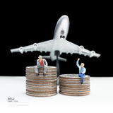Business man miniature figure concept idea to success transport. Business man miniature figure concept idea to success transportation business with coin Stock Photo