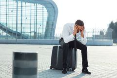 Business Man Missed Plane. Upset Man With Suitcase Is Late For Flight At Airport. High Resolution stock photo