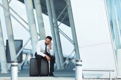 Business Man Missed Plane. Upset Man With Suitcase Is Late For Flight At Airport. High Resolution royalty free stock images