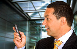 Business man with mobile phone Stock Images
