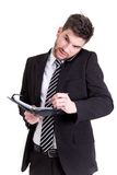 Business man with mobile phone and calendar. Picture of a business man with mobile phone and calendar Stock Photography