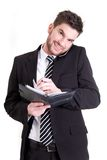 Business man with mobile phone and calendar Stock Photos