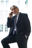 Business man with mobile phone Stock Photo