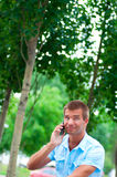 Business man with mobile phone outdoor Stock Photo