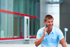 Business man with mobile phone outdoor Stock Image