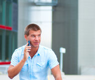 Business man with mobile phone outdoor Royalty Free Stock Photo
